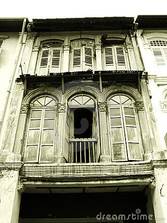Old wooden shophouse windows