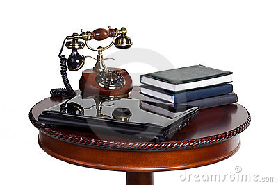 Old wooden table telephone notebook laptop