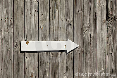 Old wooden wall with arrow sign
