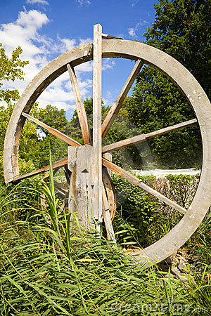 Old wooden wheel in nature