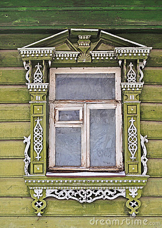 Old wooden window, decorated with carving