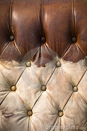 Old worn brown leather sofa vertical