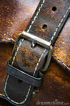 Old worn leather bag buckle detail