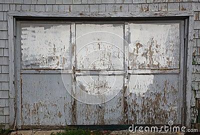 Old worn out gray garage door
