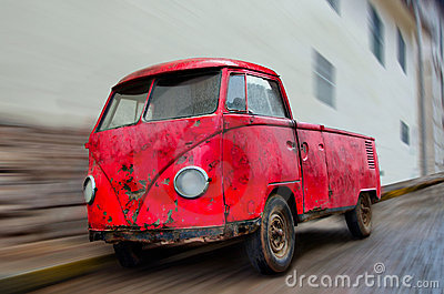 Old Wrecked Red Van Parked on Street with Blur