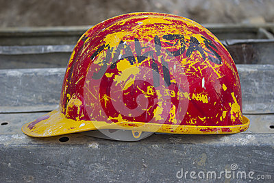 Old yellow-red hard hat