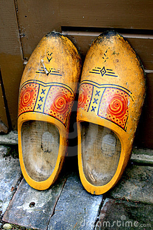 Old yellow wooden shoes