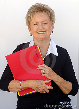 Older business woman with file folders