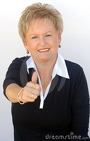 Older business woman thumbs up