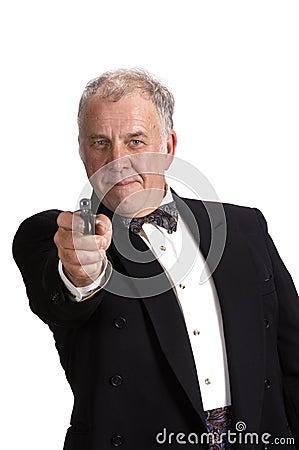 Older businessman with gun