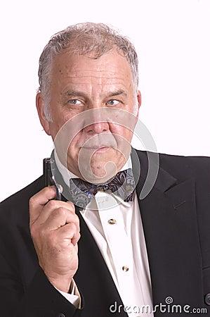 Older businessman impersonating James Bond