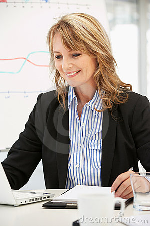 Older career woman at work in office