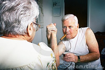Older couple arm wrestling