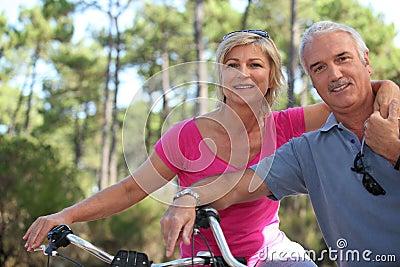 Older couple riding bikes
