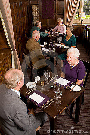 Older couples dining in restaurant
