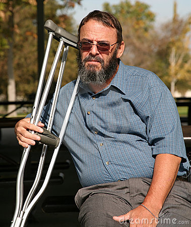 Free Older Gentleman Holding Crutches Royalty Free Stock Photography - 1572647