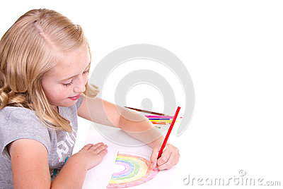 Older girl or teen drawing a rainbow