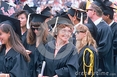 An older graduate smiles Editorial Image