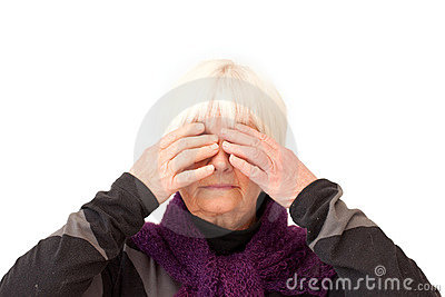 Older lady with hands over her eyes