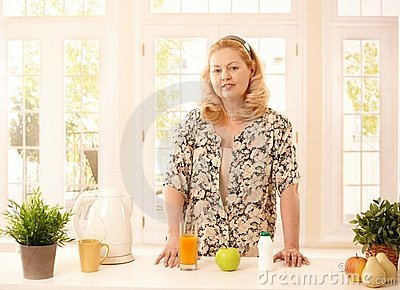 Older lady standing in kitchen
