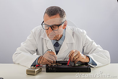 Senior Technician With Glasses, Repairing Computer