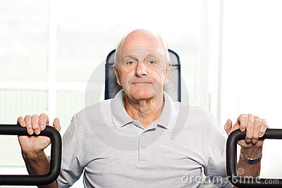 Older man exercising at the gym