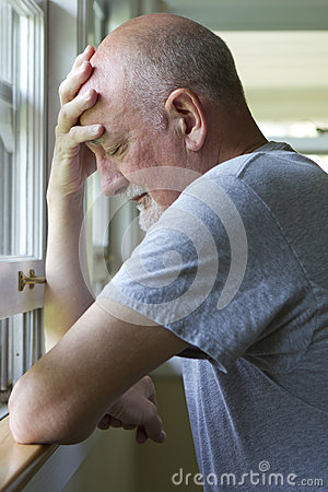Older man expressing pain or depression