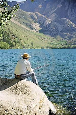Older Man Fishing at Lake