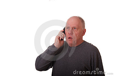 Older Man in Gray Shirt Getting Bad News on Phone