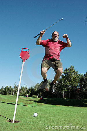 Older man jumps on golf course