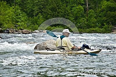 Older Man Kayaking/River Rapids