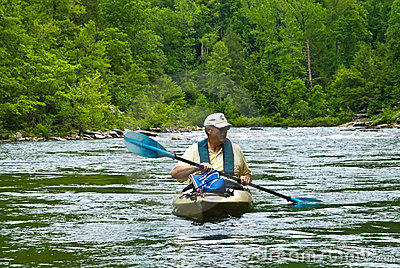 Older Man Kayaking/River Rapids