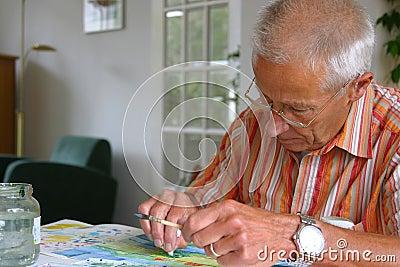 Older man painting