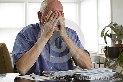 Older man paying bills