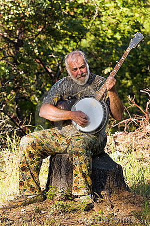 Older Man Playing the Banjo Outdoors