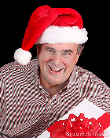 Older man with santa hat and present stock photography image