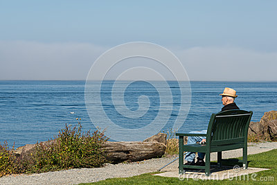 Older Man Sitting Looking Out to Sea