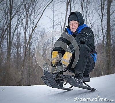 Free Older Man Tobogganing Stock Photography - 40563132