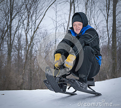 Older Man Tobogganing