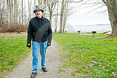 Older Man Walking in Park
