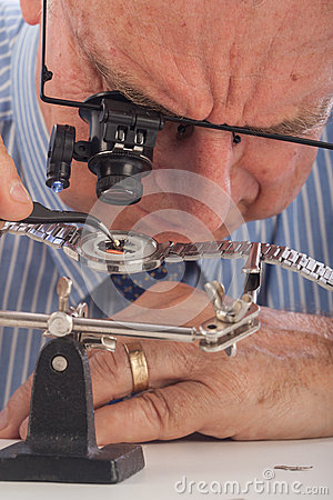 Close-Up of Man Repairing Wrist Watch