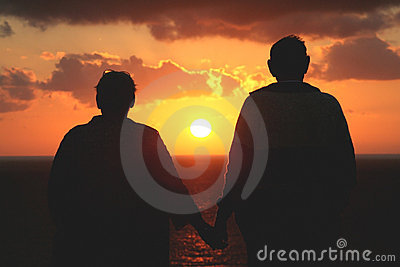 Older senior couple watching the sunset