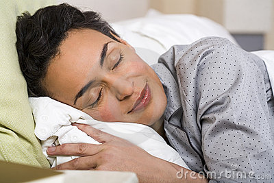 Older woman deeply sleeps in the bed