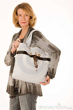 Older woman with fashionable shopping bags