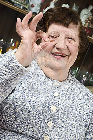 Older woman giving okay sign