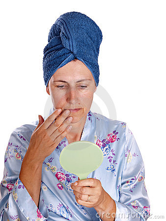 Older woman with mirror in dressing gown