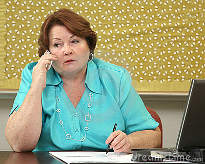 Older woman on the phone at her desk