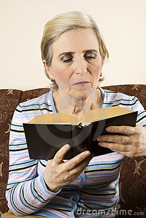 Older woman reading a book