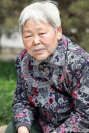 Older woman s portrait outdoor