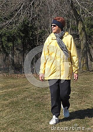 Older woman walking in winter
